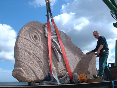The process of moving a large sculpture