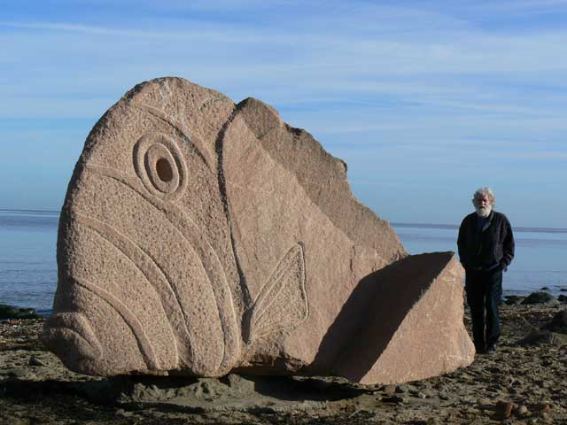 Ronald Rae with his Cramond Fish sculpture by Ronald Rae